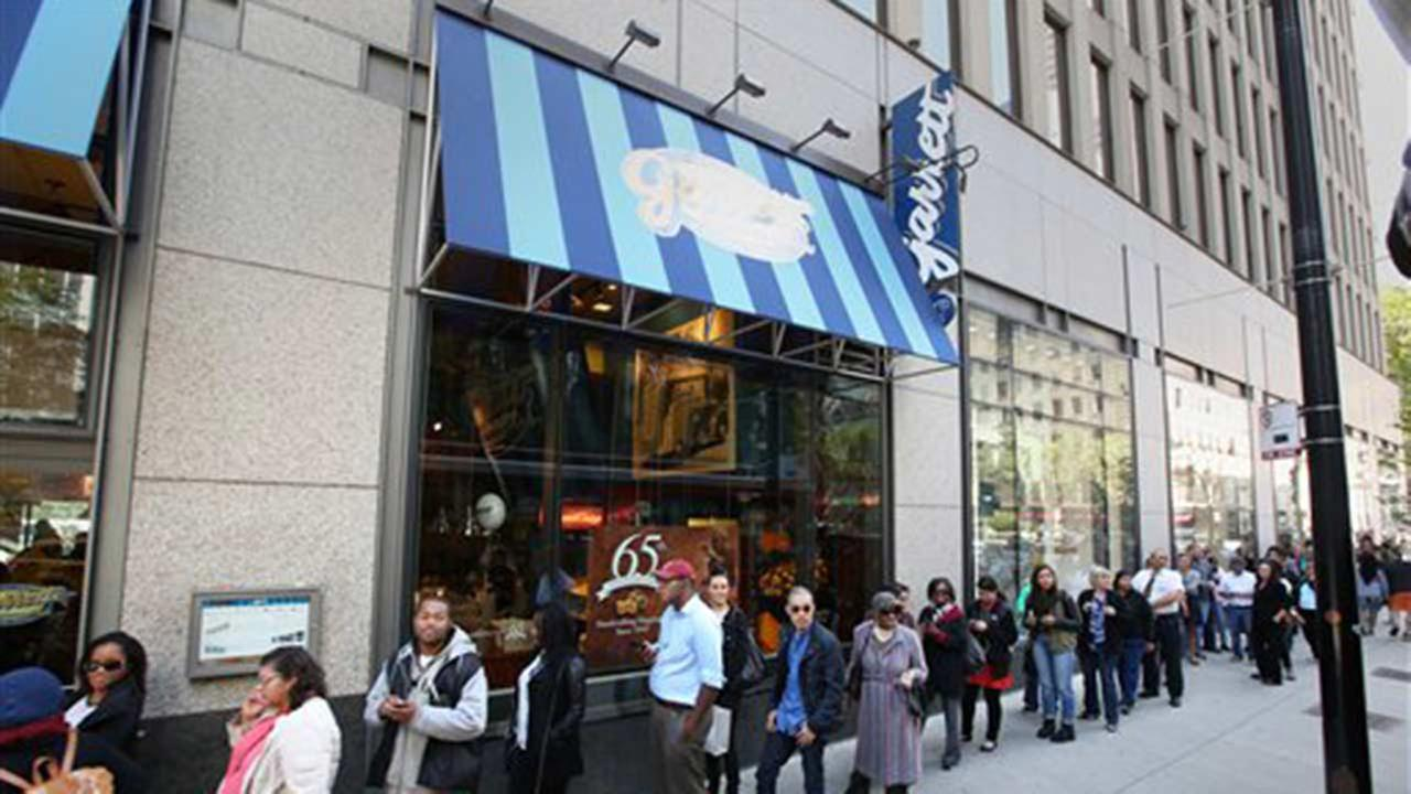 Chicagoans line up to claim 65-cent bags of Garrett Mix to celebrate the 65th anniversary of Garrett Popcorn Shops on Thursday, Sept. 18, 2014 in Chicago.