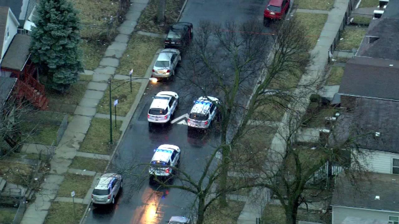 Chicago police investigate a shooting in the 7300-block of South May Street Tuesday.
