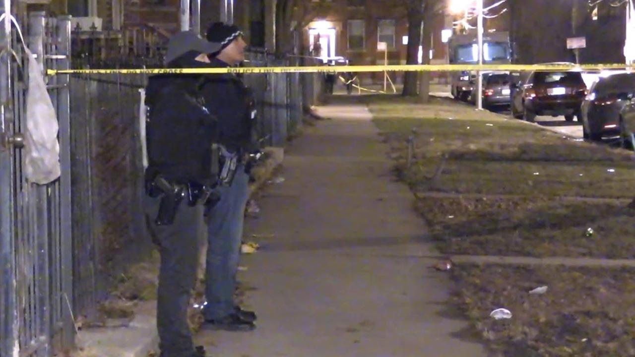 Police investigate after a double homicide in Woodlawn early Saturday.