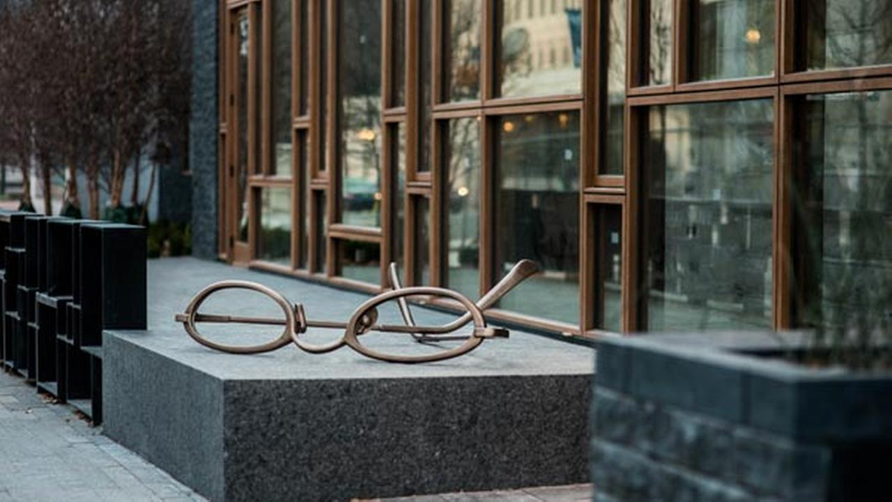Oversized eyeglasses greet guests at The Study at University City, a new boutique hotel. The sculpture represents the moment when readers finally put their glasses down.