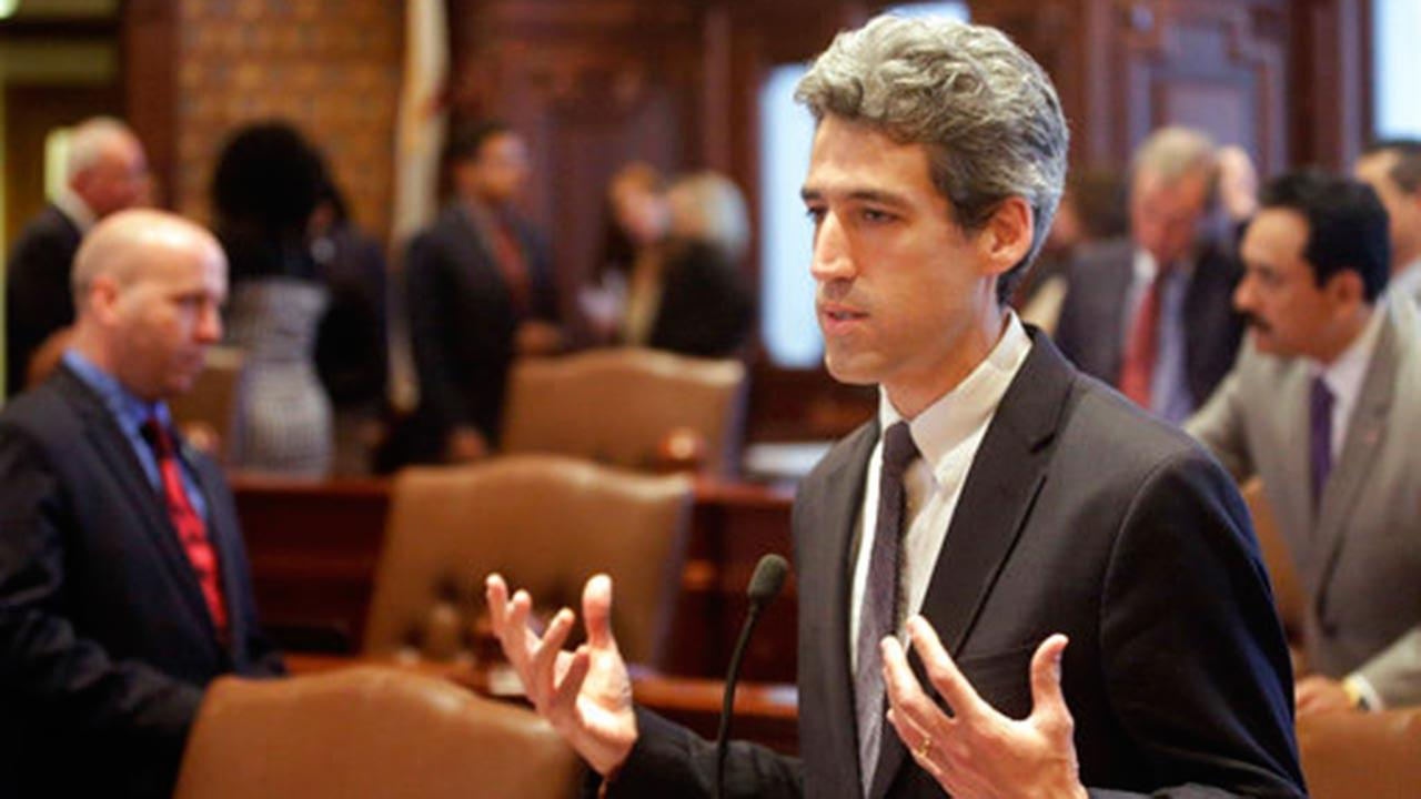 llinois Sen. Daniel Biss, D-Skokie, speaks to lawmakers while on the Senate floor at the Illinois State Capitol in Springfield, Ill.