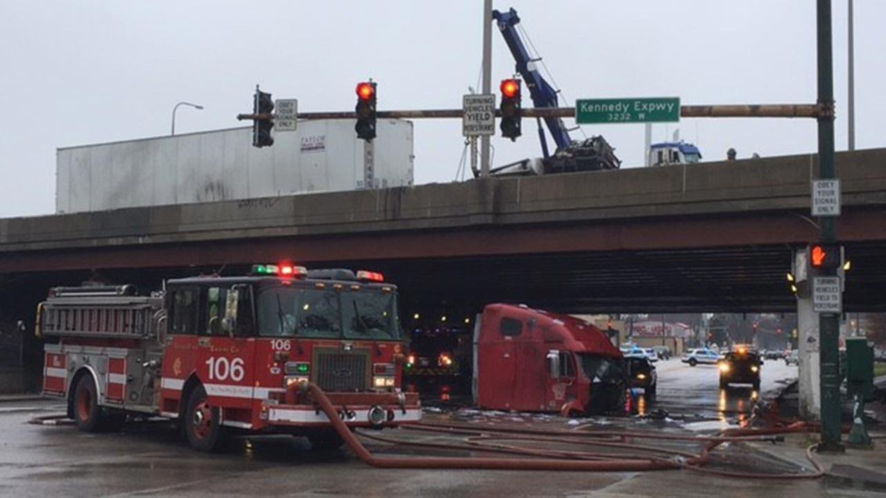 A driver was injured after the cab of his semi-truck fell from an overpass on the Kennedy Expressway.