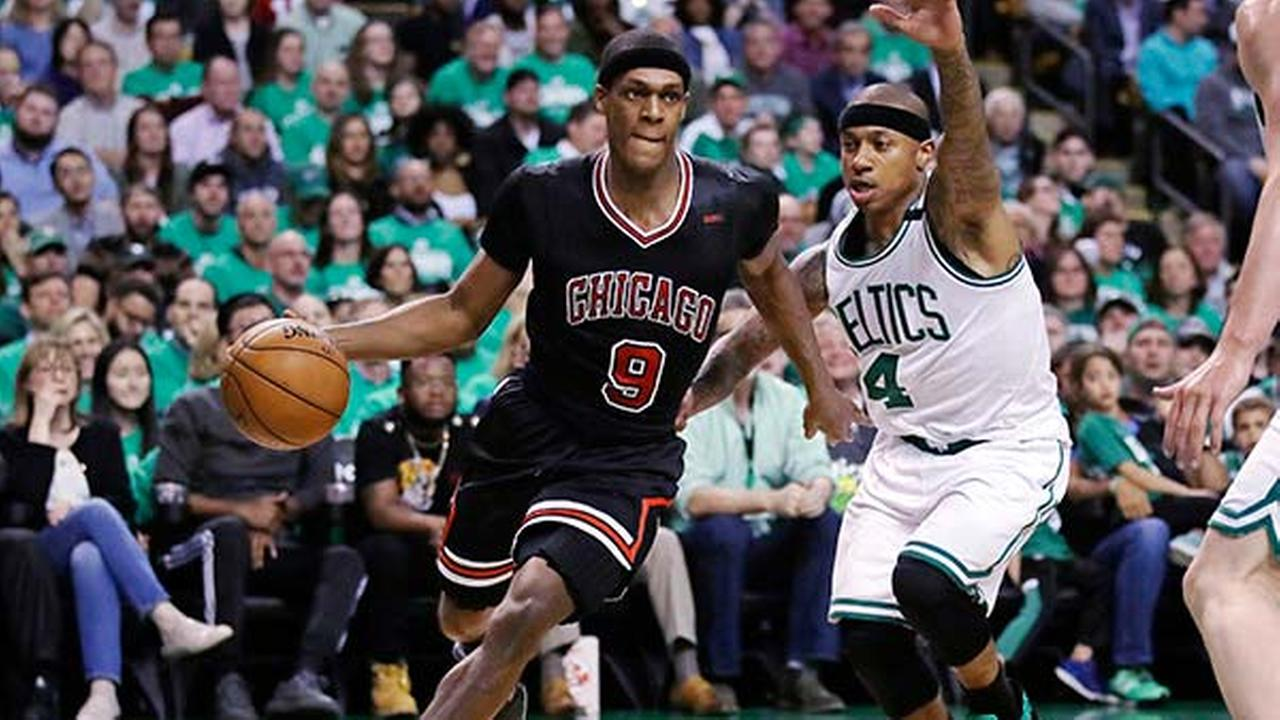 Chicago Bulls guard Rajon Rondo drives towards the basket past Boston Celtics guard Isaiah Thomas during the second quarter of a first-round NBA playoff basketball game in Boston.