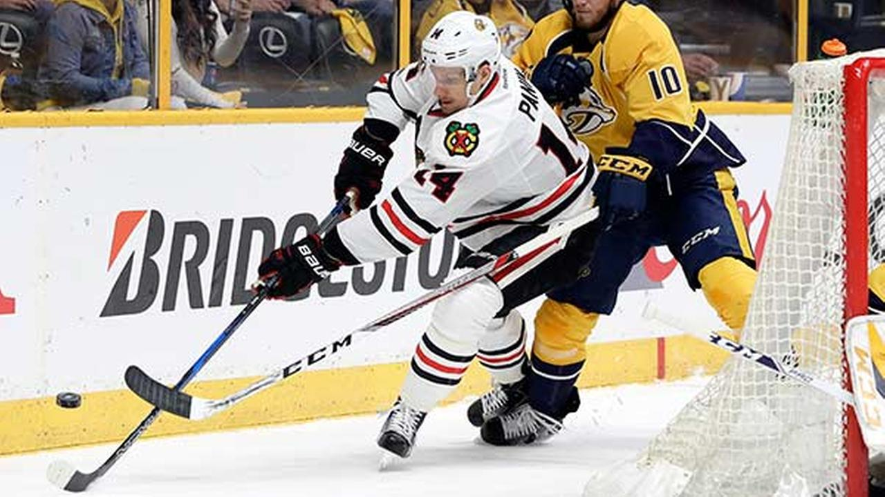 Chicago Blackhawks left wing Richard Panik (14), of Slovakia, and Nashville Predators center Colton Sissons (10) chase the puck during the first period in Game 4.