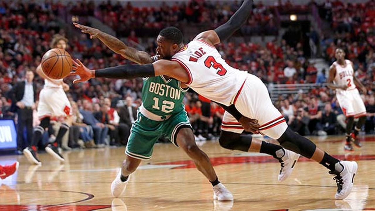 Chicago Bulls Dwyane Wade (3) and Boston Celtics Terry Rozier vie for a loose ball during the first quarter of Game 3 of a first-round NBA basketball playoff series in Chicago.