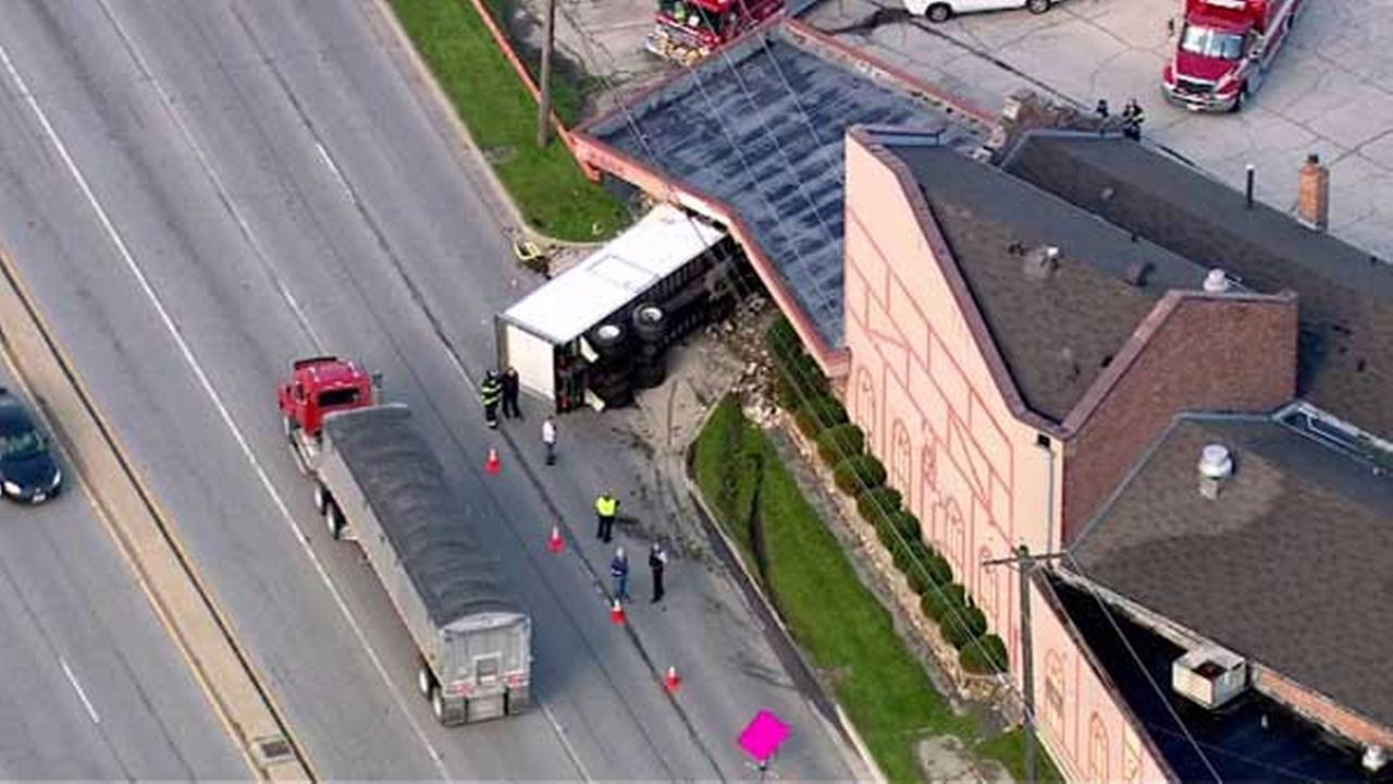 Truck crashes into Bedford Park banquet hall