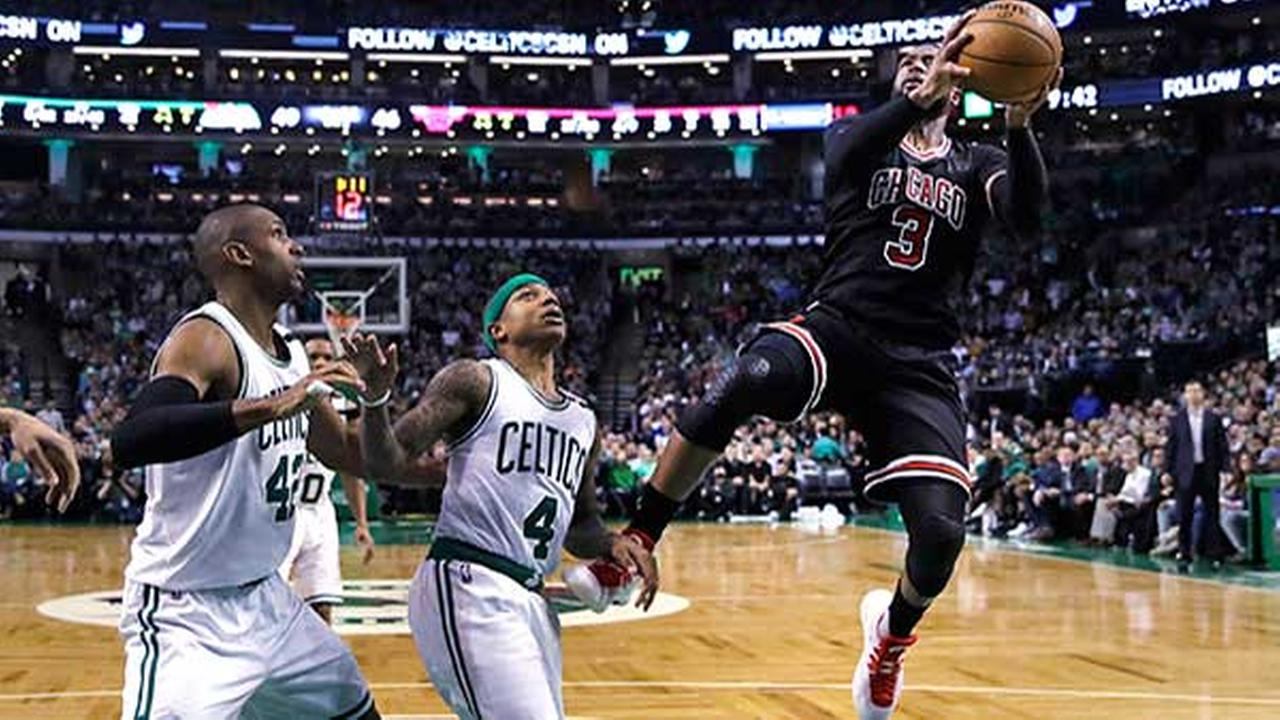 Chicago Bulls guard Dwyane Wade (3) shoots over Boston Celtics guard Isaiah Thomas (4) and center Al Horford (42) on a drive to the basket in Game 5 of the NBA playoffs.
