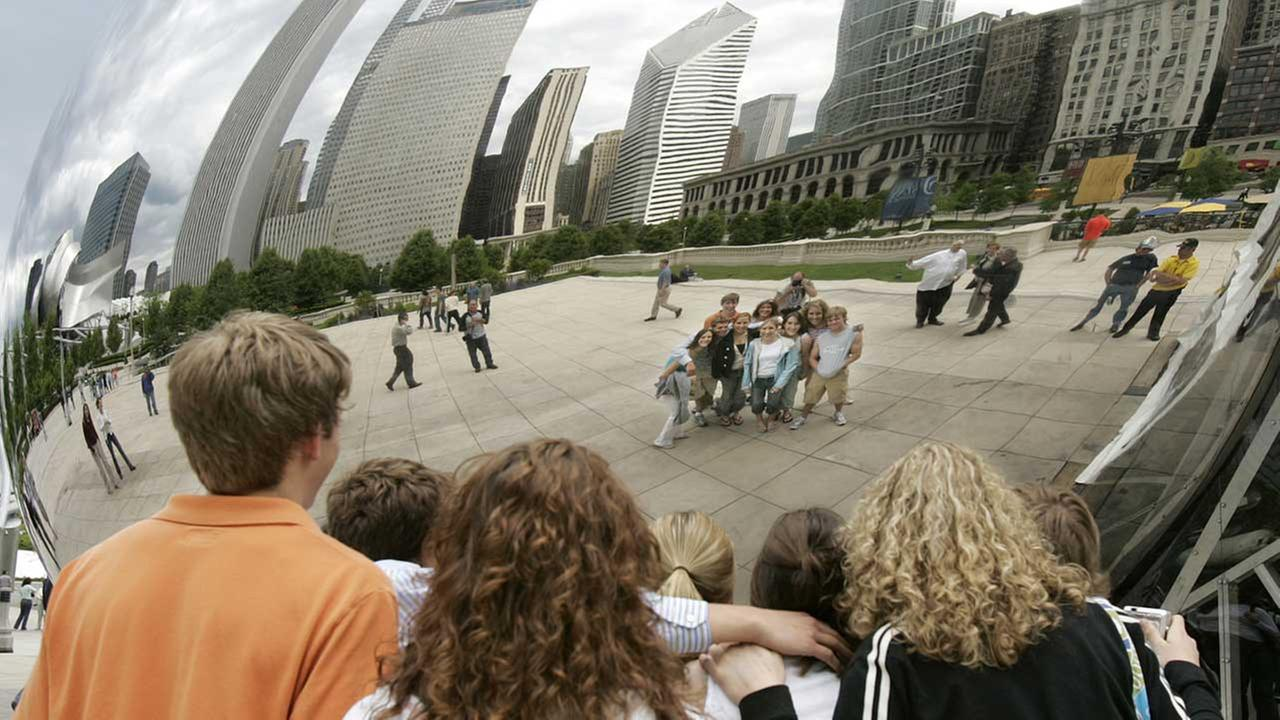 High School seniors post in front of Cloud Gate on Friday, May 27, 2005.