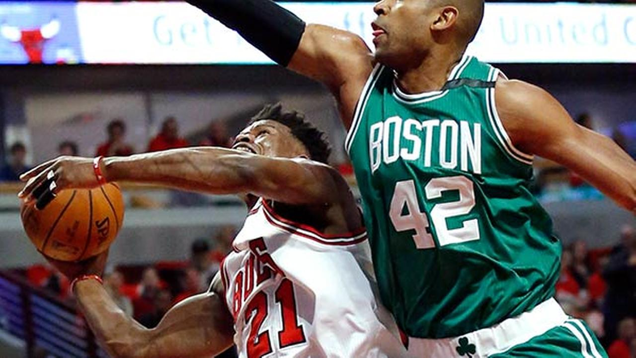 Chicago Bulls Jimmy Butler, left, drives to the basket against Boston Celtics Al Horford during the first half in Game 6 of an NBA basketball first-round playoff series.