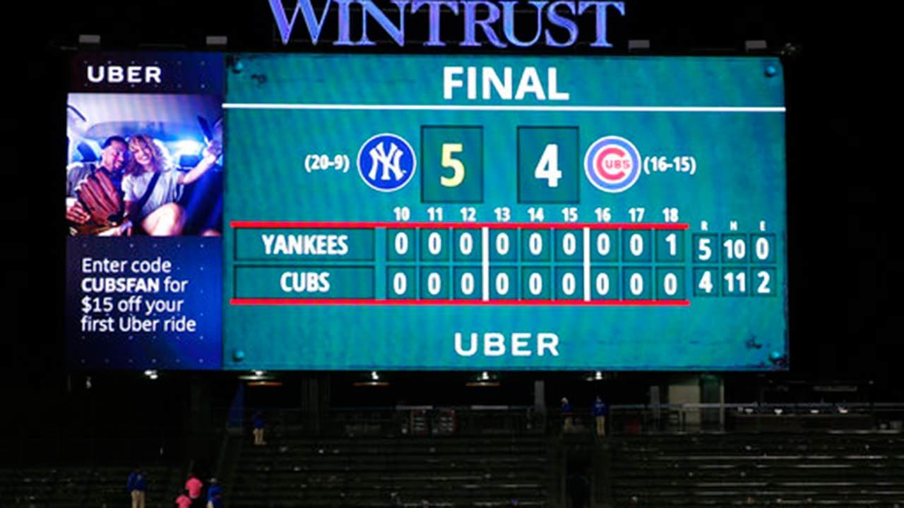 Yankees top Cubs in record setting marathon game