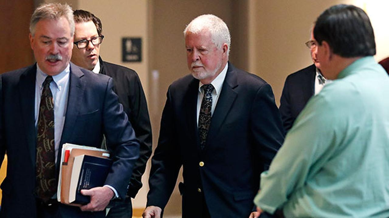 Arthur Peekel follows his lawyer Philip Utter, left, past reporters after appearing at a hearing at Rockingham County Superior Court in Brentwood, N.H.