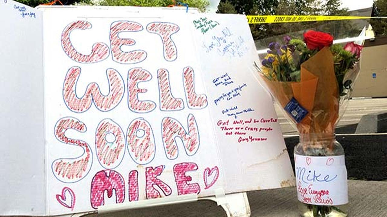 Well-wishing messages and flowers for an injured employee are shown outside a grocery store in Estacada, Ore., Monday, May 15, 2017.