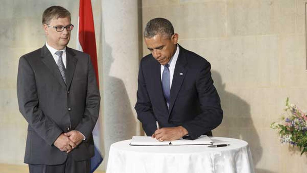 President Barack Obama visits the Dutch Embassy in Washington to sign a book of condolence, joined by Deputy Chief of Mission Peter Mollema.