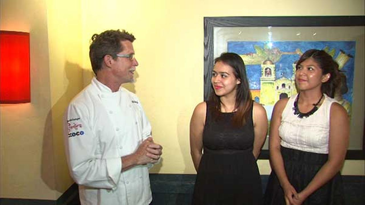Rick Bayless awards his culinary scholarship to two CPS students Wednesday.