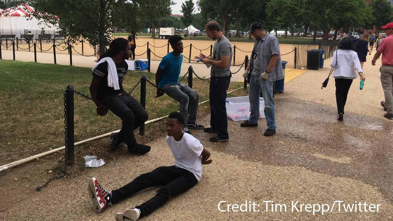 Three teens being handcuffed on the National Mall in Washington, D.C. were handcuffed for selling bottled water.
