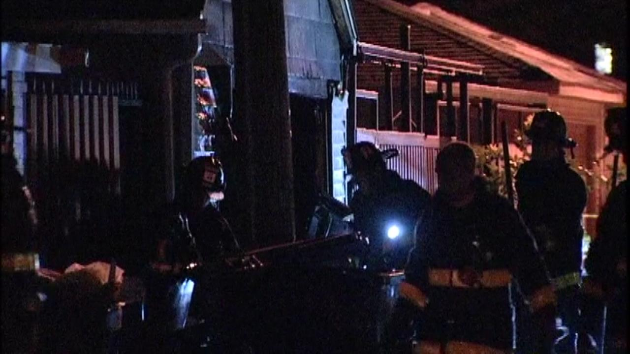 Firefighters respond to a garage fire in the Back of the Yards neighborhood Monday night.