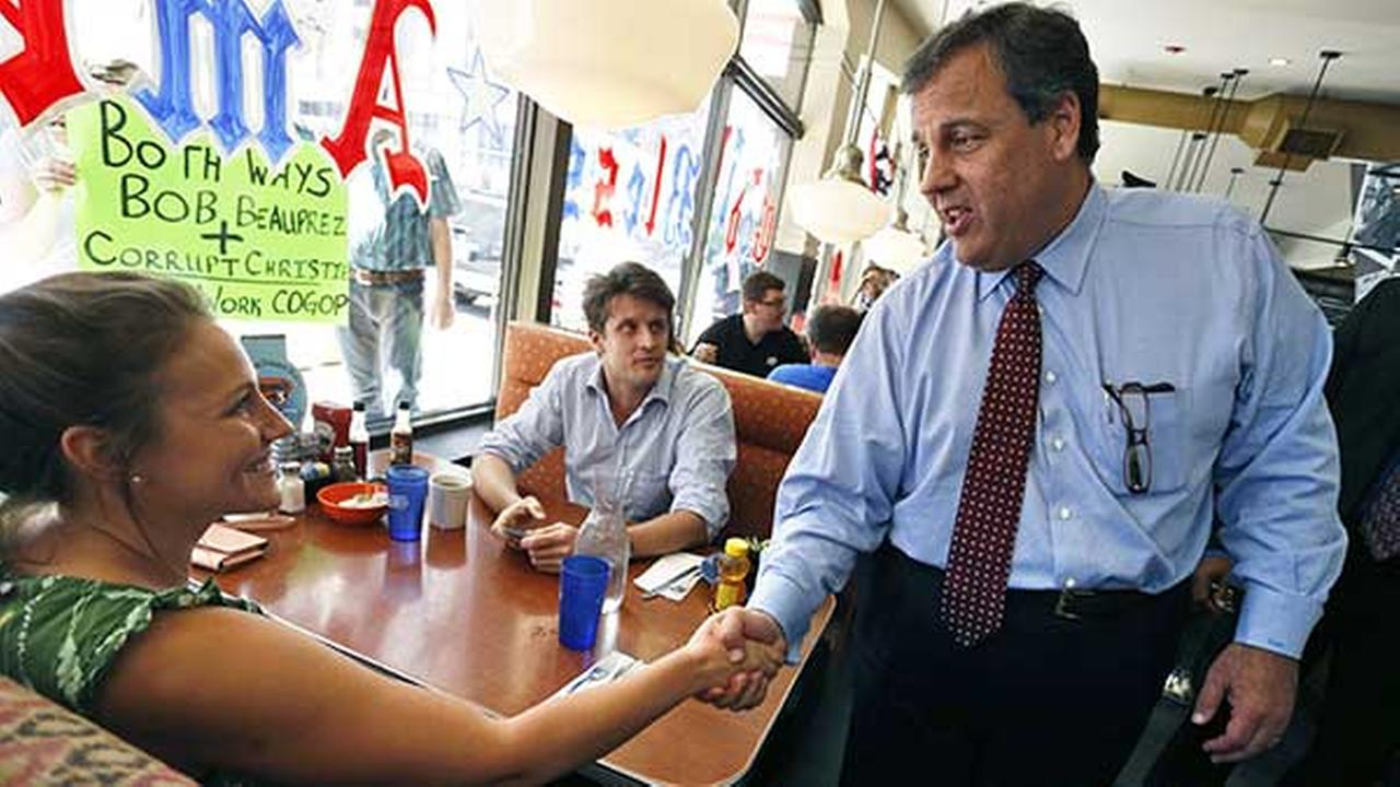 New Jersey Gov. Chris Christie shakes hands with Kiki Fornito during a stop in Denver to support GOP gubernatorial contender Bob Beauprez on July 23, 2014.