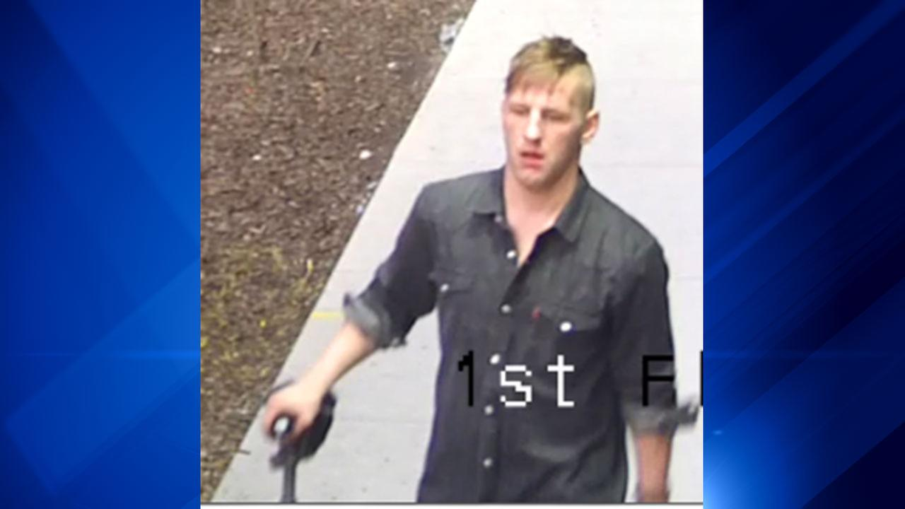 A suspect in a series of South Loop bike thefts walks with a bike. Chicago Police Department