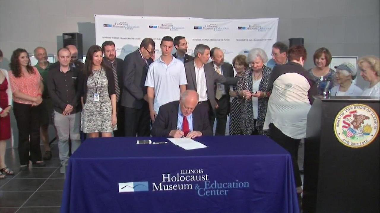 Governor Pat Quinn signed legislation on Sunday to expand the Illinois Holocaust and Genocide Commission.