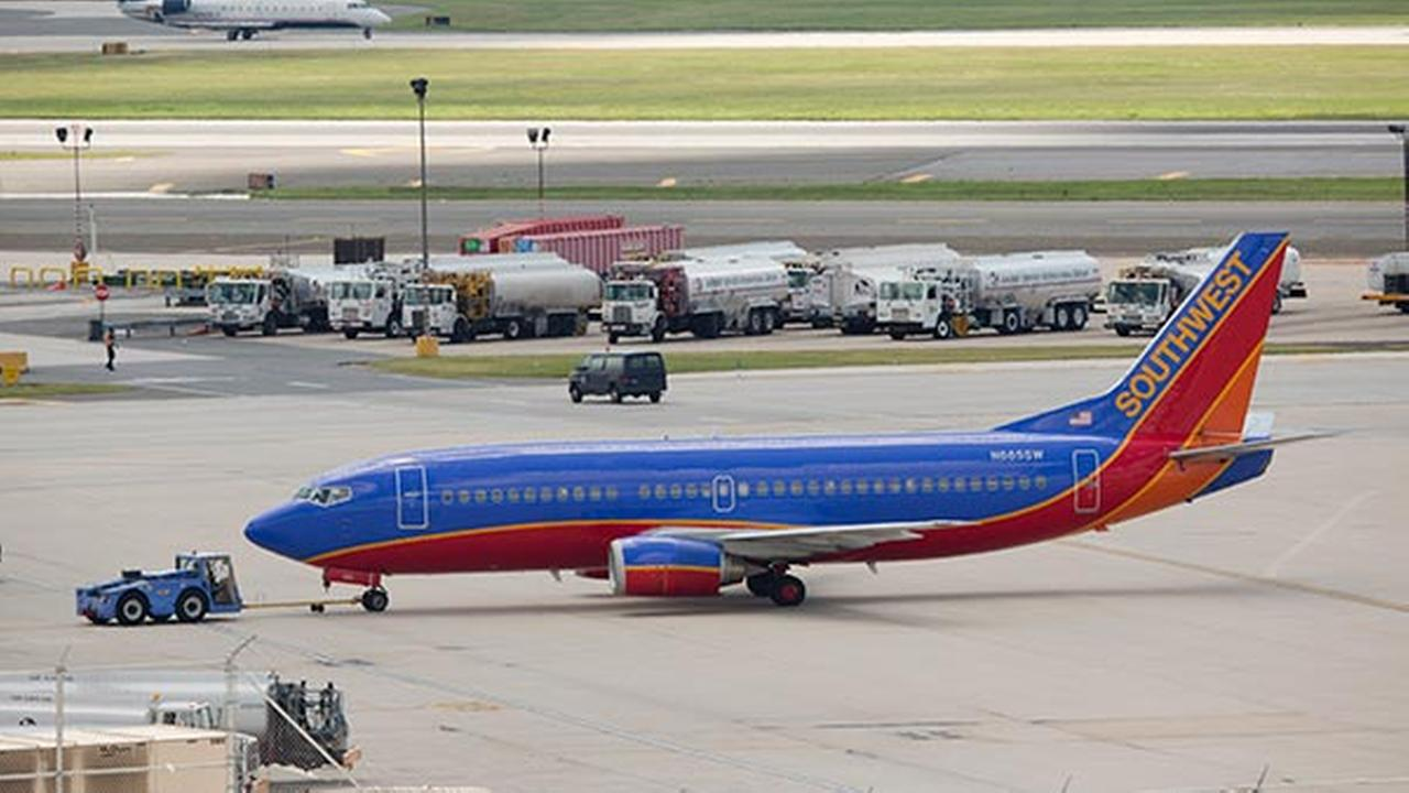 A Southwest Airlines airplane is pushed away from a terminal at the Philadelphia International Airport, Thursday, July 17, 2014.