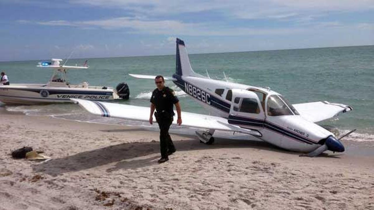 This photo provided by the Sarasota County Sheriffs Office shows emergency personnel at the scene of a small plane crash in Caspersen Beach in Venice, Fla.
