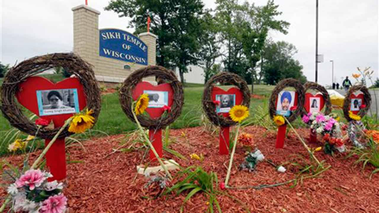 A makeshift memorial is seen before a candlelight vigil in the parking lot the Sikh Temple of Wisconsin, Monday, Aug. 5, 2013, in Oak Creek, Wis.