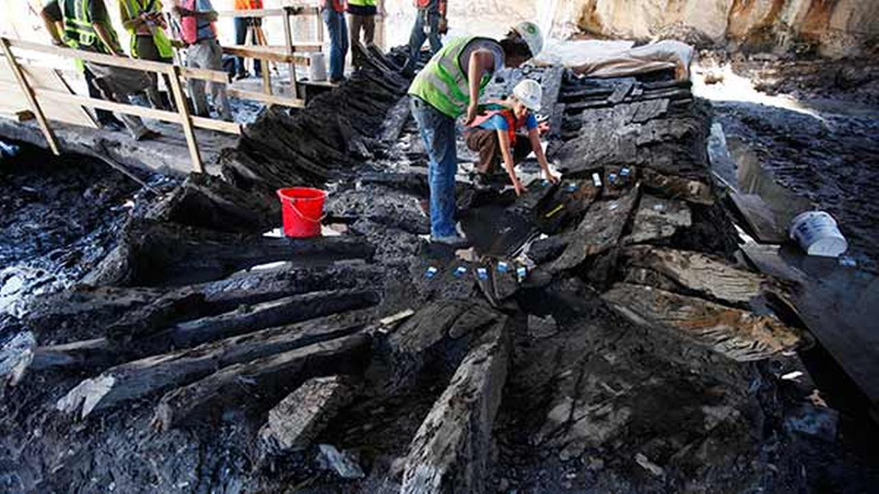 Archeologists begin dismantling the remains of an 18th century ship at the World Trade Center construction site, Monday, July 26, 2010 in New York.