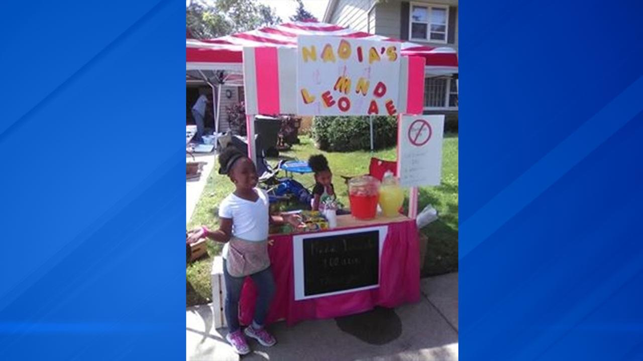 A young girl sells tax-free lemonade in Country Club Hills.