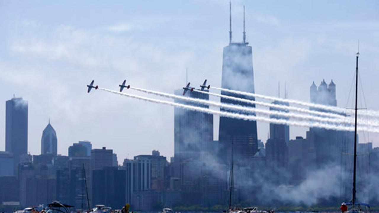 The Aerostars, precision aerobatic teams, perform as they fly over Lake Michigan along downtown Chicago, Saturday, Aug. 19, 2017, during the Chicago Air and Water show.