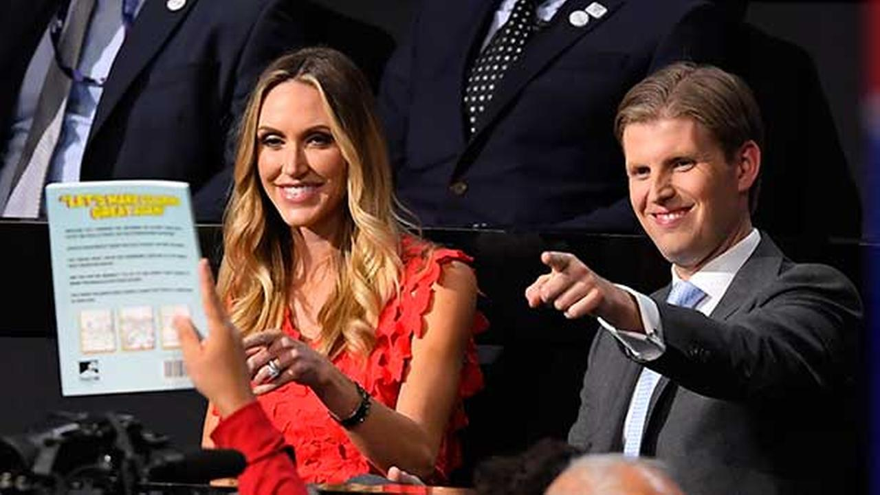 Donald Trumps son Eric Trump, right and wife Lara interact with the crowd during the second day of the Republican National Convention in Cleveland, Tuesday, July 19, 2016.