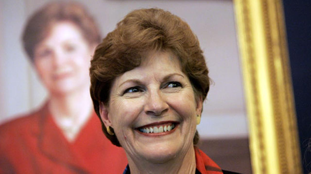 Former N.H. Gov. Jeanne Shaheen smiles after the unveiling of her portrait, in background, at the N.H. Historical Society in Concord, N.H. Thursday, May 17, 2007.