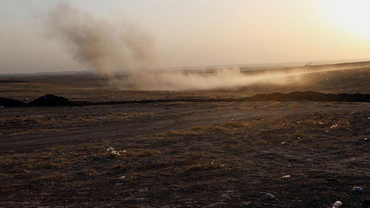 Smoke rises from airstrikes targeting Islamic State militants near the Khazer checkpoint outside of the city of Irbil in northern Iraq, Friday, Aug. 8, 2014.