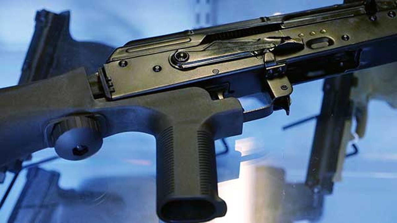 A little-known device called a bump stock is attached to a semi-automatic rifle at the Gun Vault store and shooting range Wednesday, Oct. 4, 2017, in South Jordan, Utah.