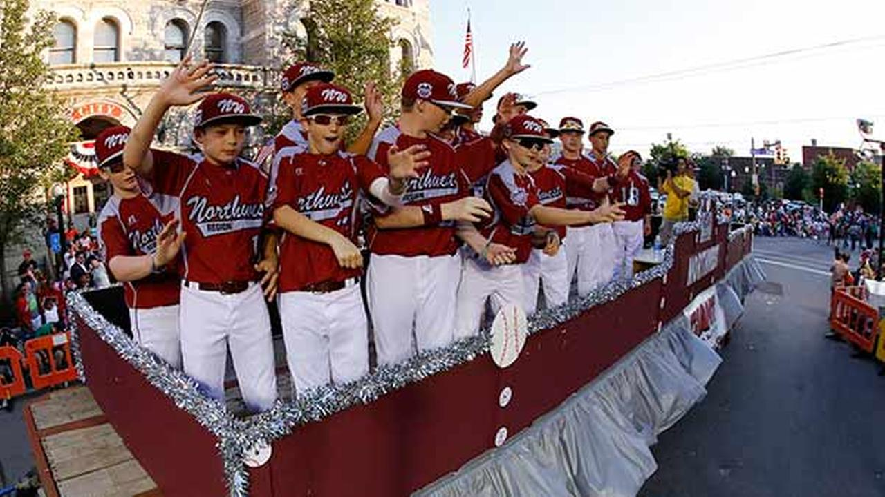 The Lynnwood Pacific Little League team from Washington, Jackie Robinson Wests Thursday opponent, ride in the Little League Grand Slam Parade through downtown Williamsport, Pa.Gene J. Puskar