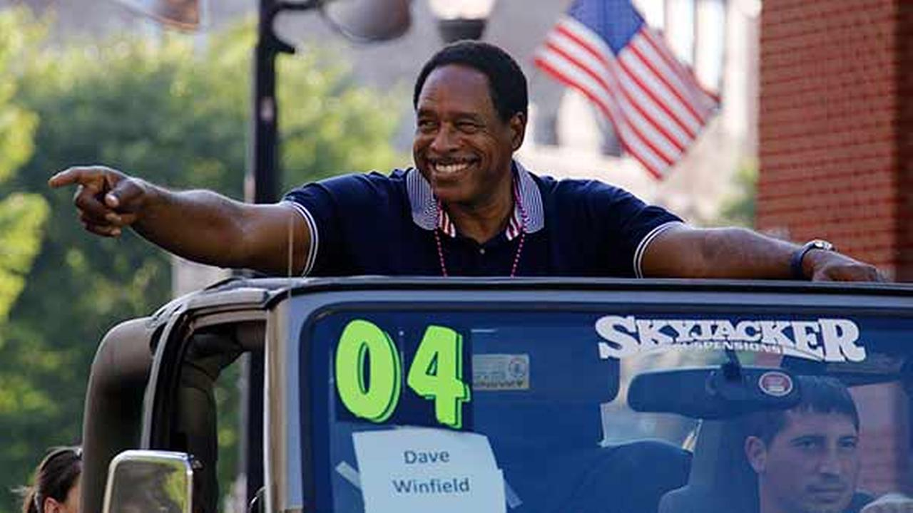 Baseball Hall of Famer Dave Winfield rides in the Little League Grand Slam Parade through downtown Williamsport, Pa. Winfield throwing out a ceremonial first pitch Thursday.Gene J. Puskar
