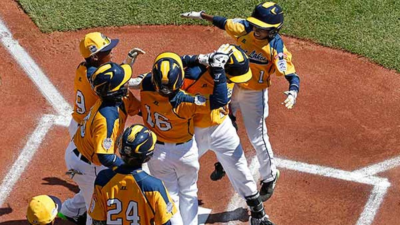 Chicagos Pierce Jones, center, is greeted by teammates after hitting a solo home run off Lynnwood, Washington pitcher Ian Michael during the first inning.Gene J. Puskar