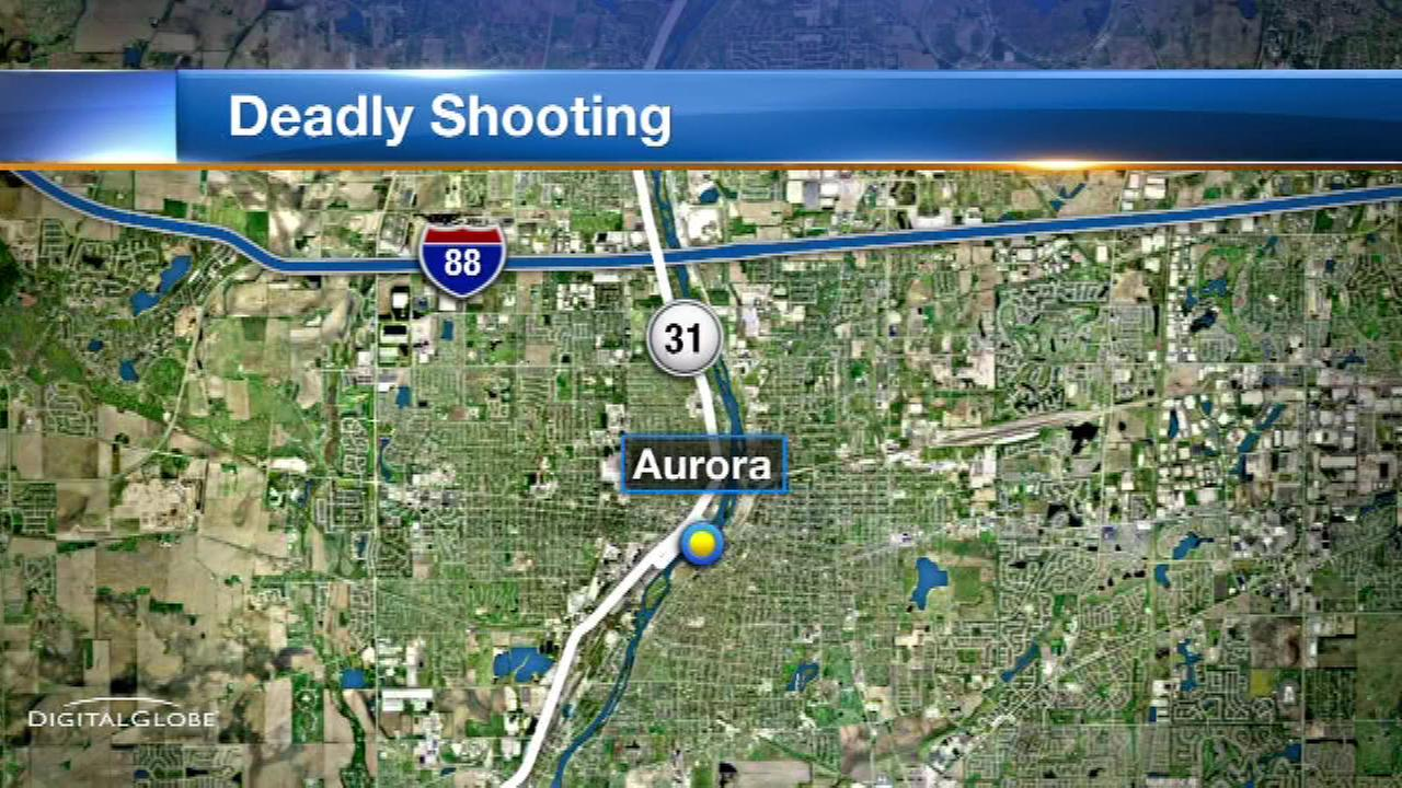 A man was killed and his girlfriend was wounded in a shooting early Saturday in west suburban Aurora.