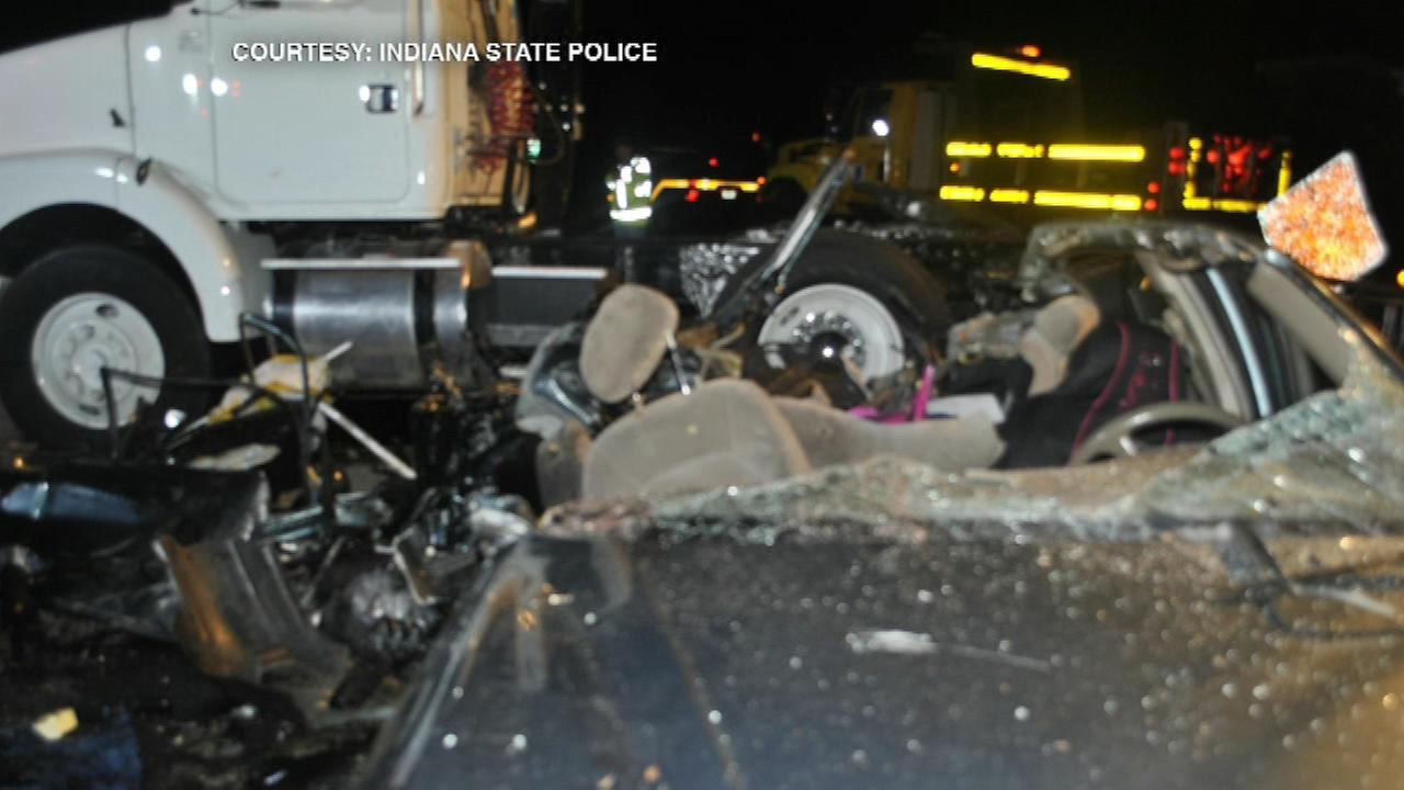 A Chicago woman was killed and three other people were injured when a semi truck ran over a car in northwest Indiana Friday night, the Post-Tribune is reporting.