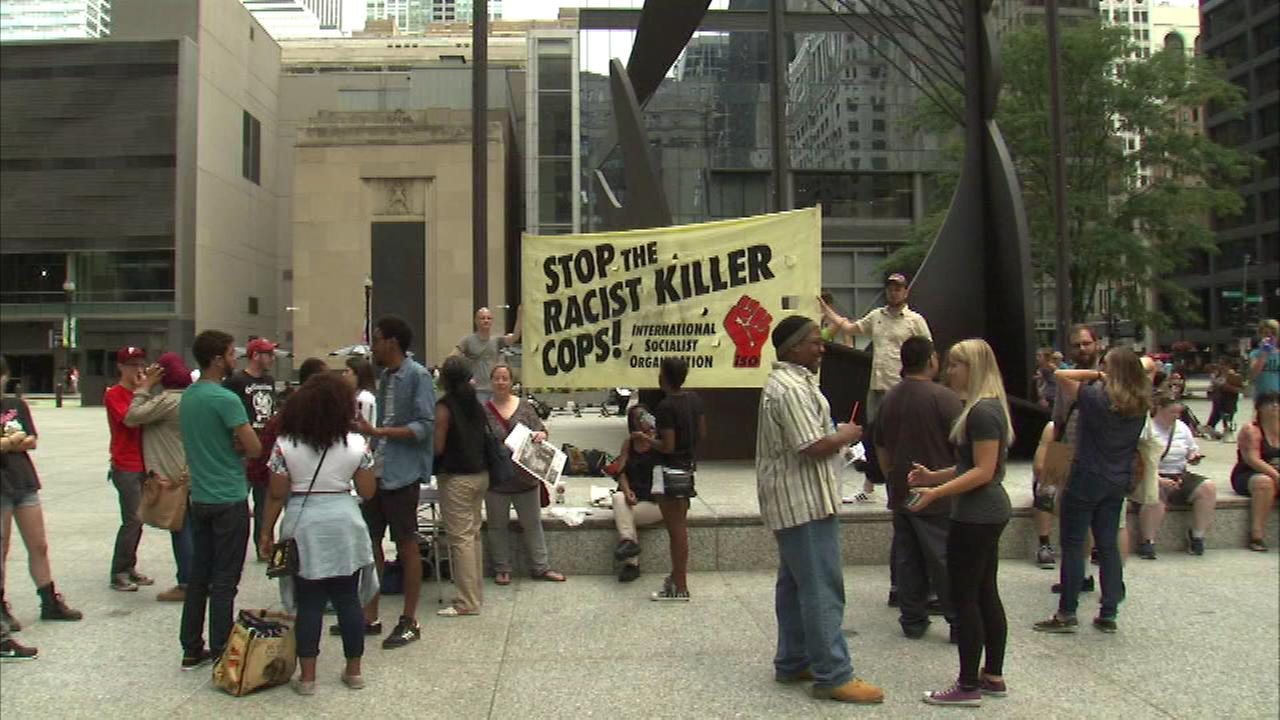 Protesters rallied Saturday in downtown Daley Plaza to make a call for justice in the wake of the shooting death of Michael Brown in Ferguson, Missouri.