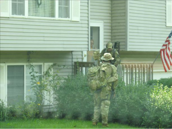 <div class='meta'><div class='origin-logo' data-origin='none'></div><span class='caption-text' data-credit='WLS Photo/ Marcin & Ewa Dabrowsky'>Authorities search door-to-door in Fox Lake for three suspects believed to be armed and dangerous after a police officer was fatally shot on Sept. 1, 2015.</span></div>
