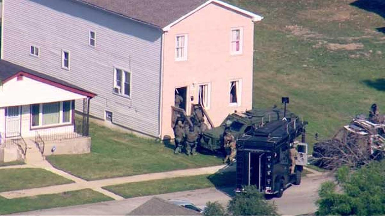 SWAT team officers swarmed a home in Harvey Wednesday after a nearly 21-hour standoff with police.