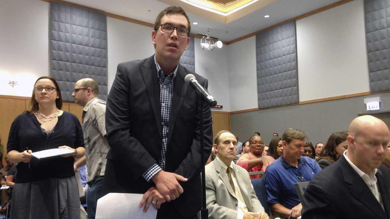 James Watts asks a question on Wednesday, Aug. 20, 2014, in Chicago during the last of three town hall meetings on Illinois medical marijuana program.
