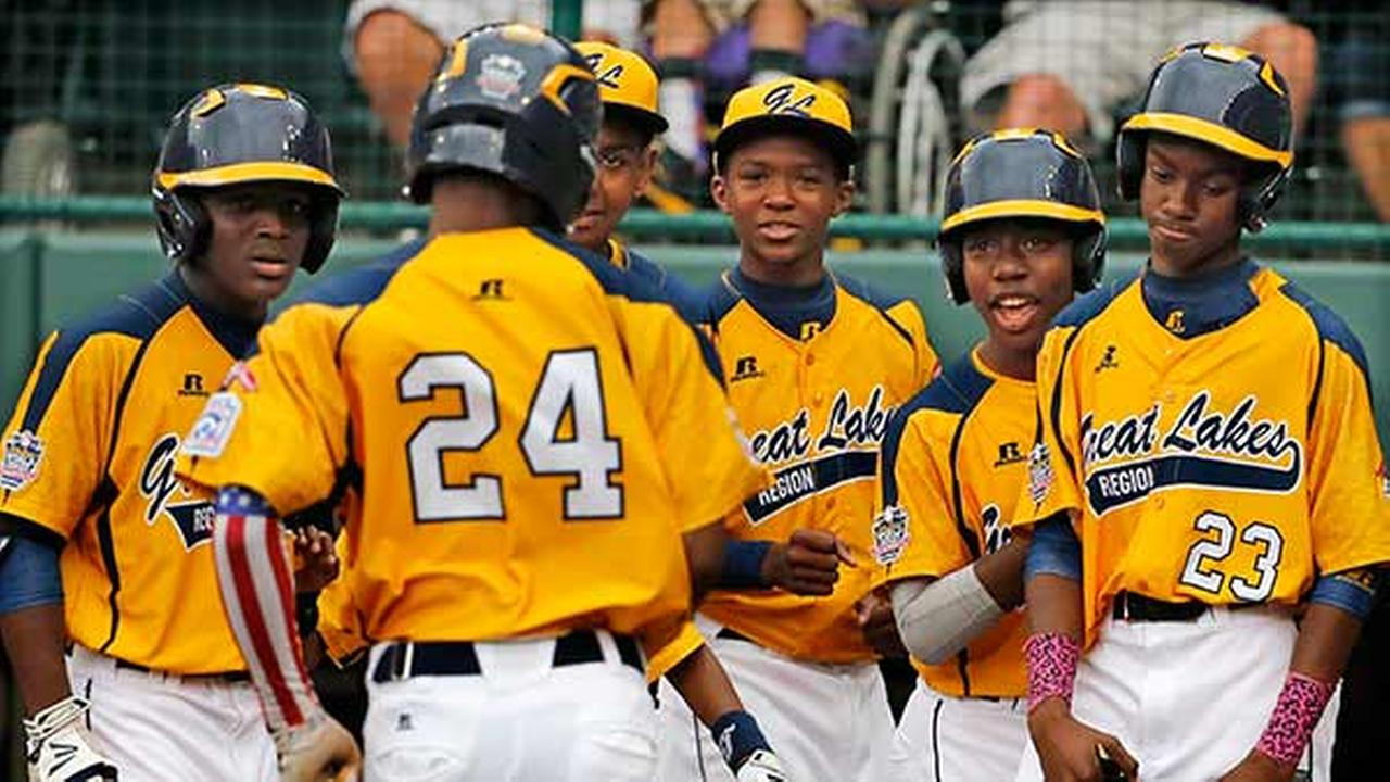 Chicagos Trey Hondras (24) is greeted by teammates after hitting a two-run home run off Las Vegas Brennan Holligan in the first inning of a United States Championship.Gene J. Puskar