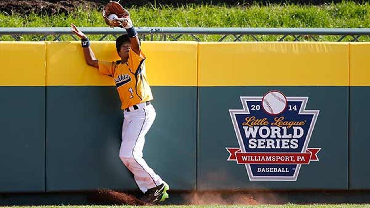 Chicago center fielder DJ Butler (1) catches a ball to the wall by South Koreas Jae Yeong Hwang in the fifth inning of the Little League World Series championship.Gene J. Puskar