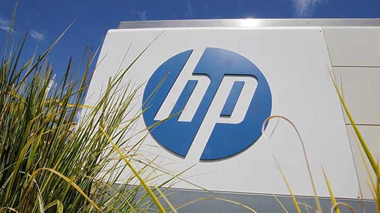 FILE - In this Aug. 21, 2012, file photo, the Hewlett-Packard Co. logo is seen outside the companys headquarters in Palo Alto, Calif.
