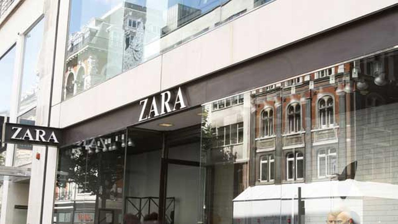 FILE: People walk by a ZARA store in Oxford Street, London, Friday, Sept. 3, 2010.