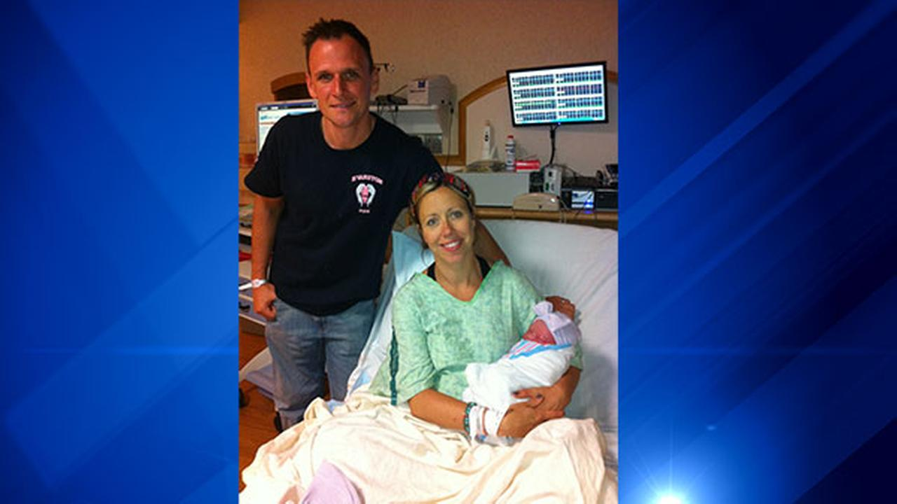 Dan Lynch and Elizabeth Lynch with newborn daughter, Mary.