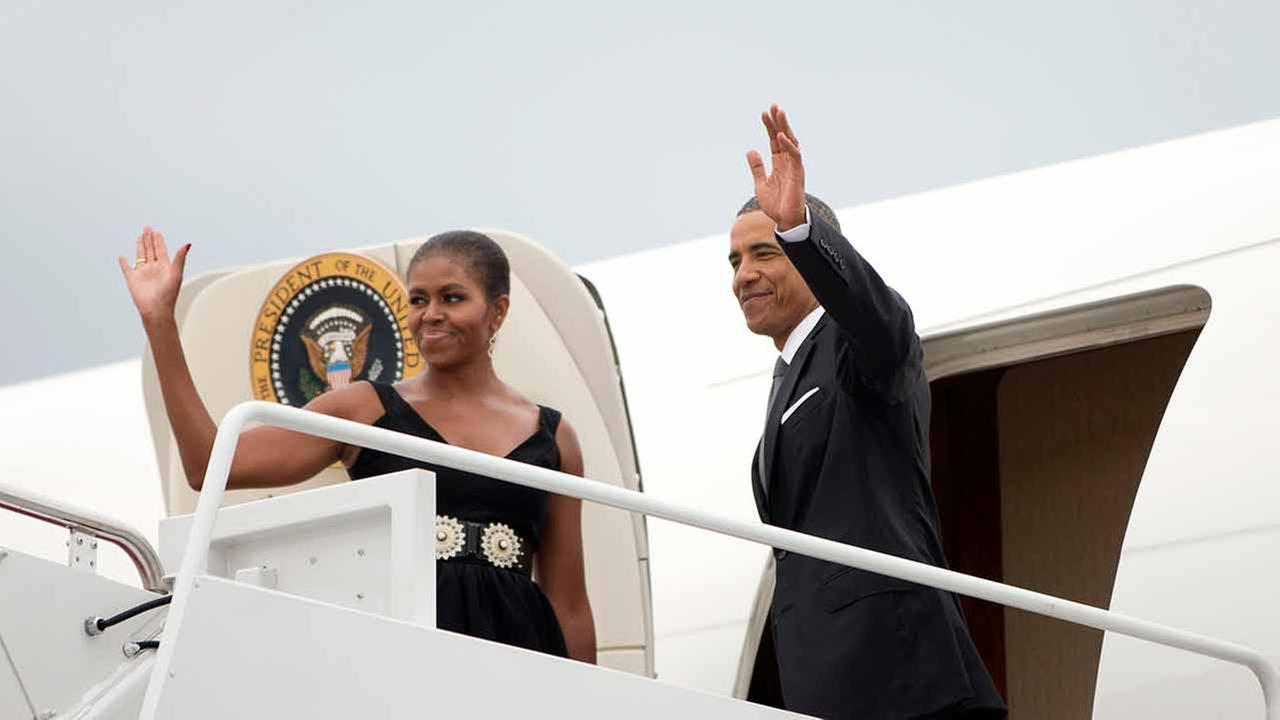 President Barack Obama, right, and first lady Michelle Obama board Air Force One before their departure from Andrews Air Force Base, Saturday, Aug. 30, 2014.