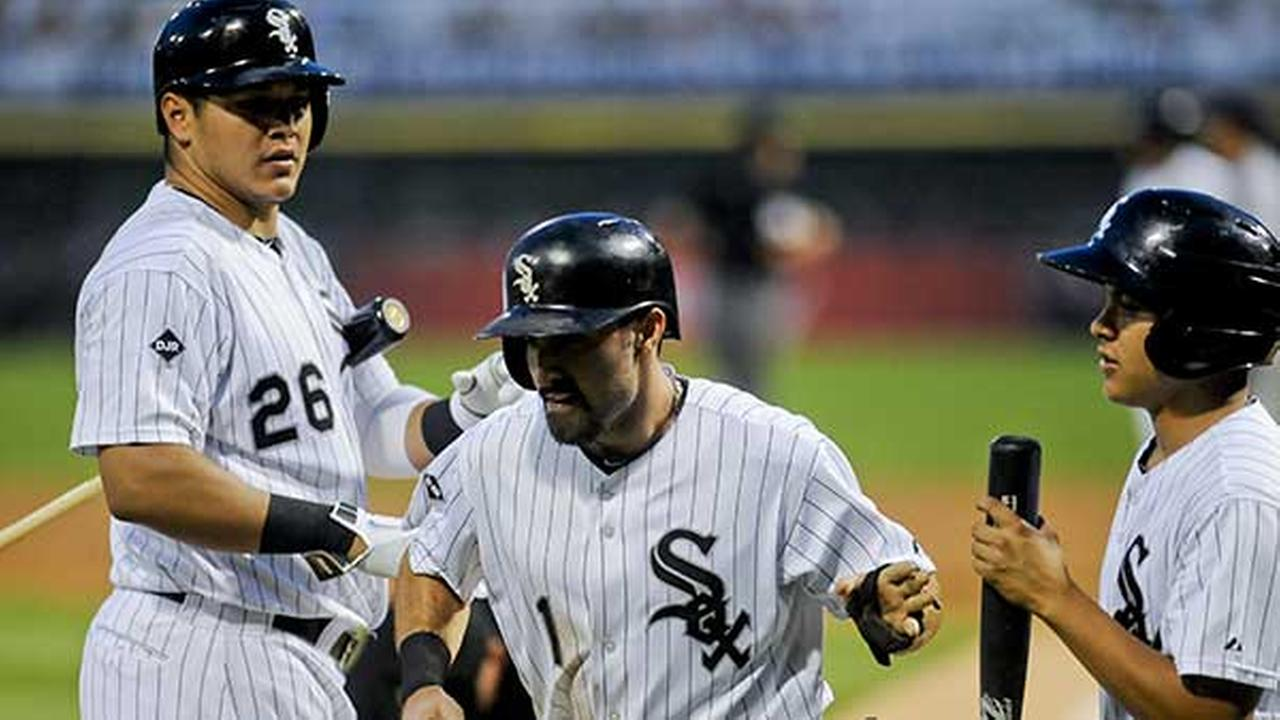 Chicago White Soxs Adam Eaton scores on a sacrifice fly hit by Adam Dunn against the Detroit Tigers during the first inning of a baseball game in Chicago on Aug. 29, 2014.
