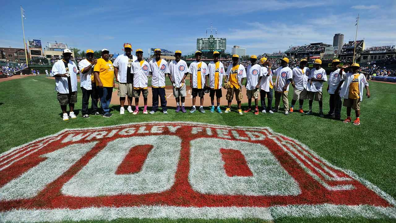 Members of the Jackie Robinson West little league team is honored before a baseball game between the Chicago Cubs and Milwaukee Brewers at Wrigley Field.